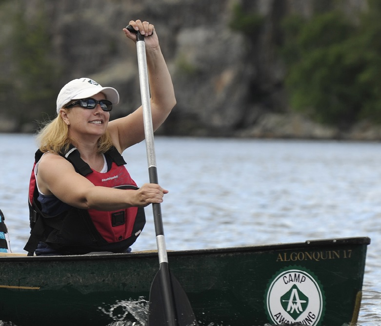 Portrait of Executive Director Tracy Morley canoeing