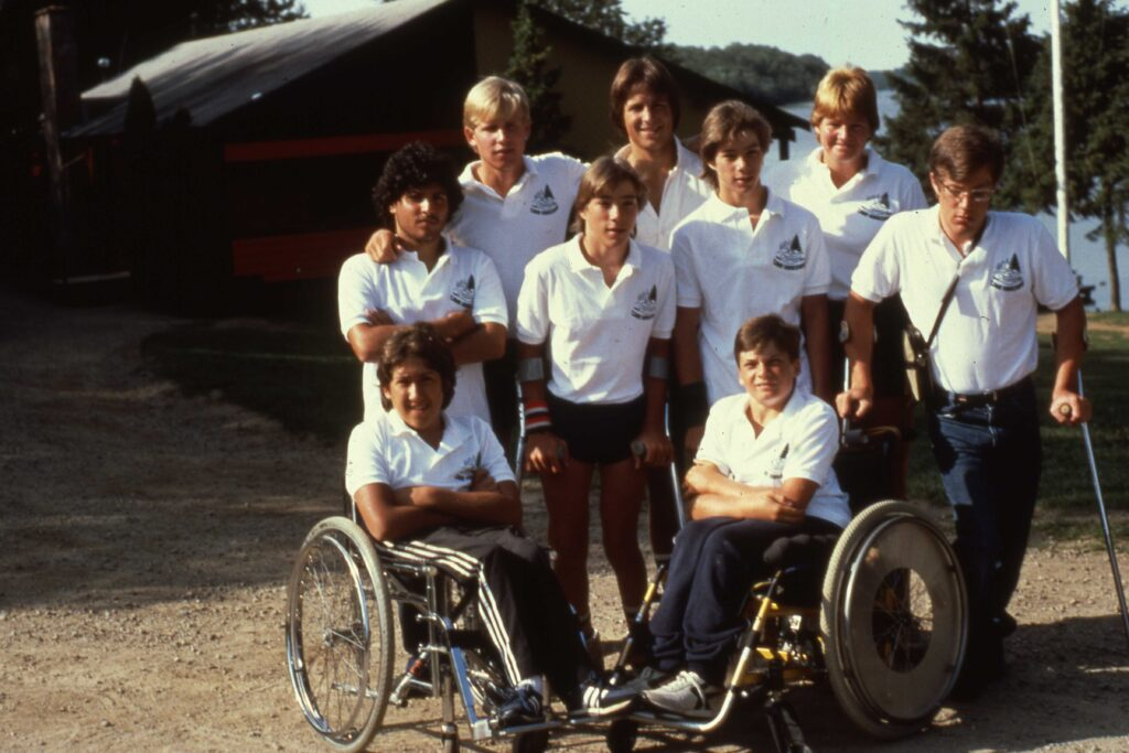 Archive cabin group photo of campers and staff in uniform from 1983 or 1984